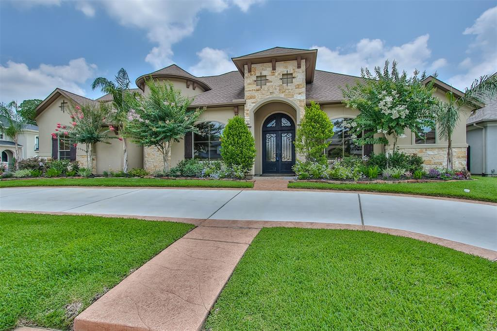 Exceptional luxury custom home in the exclusive, gated Reserve section of Champion Wood. This home boasts of quality and is designed with attention to detail from the gorgeous architecture to the finest fixtures & finishes. Thoughtfully planned layout accommodates your guests or multi-generational family with 3 downstairs bed/baths, including a fabulous master suite, plus quiet study & formal living & dining rooms. Upstairs, unwind in the game room with Juliet balcony, or the furnished & equipped media room, and 2 more bed/baths.  Relaxing private backyard sanctuary features inviting pool & spa with stunning glass pebble gas fire pit to compliment the generous covered outdoor living area complete with outdoor kitchen, stone gas fireplace & cabana bath. Complete suite of Thermador stainless steel appliances including 6 burner gas range with grill & double oven, wireless Silhouette shades, surround sound, Rainsoft water softener. Available for your private viewing & certain to impress.