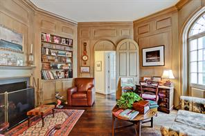 The fireplace and built-ins in the study/library.