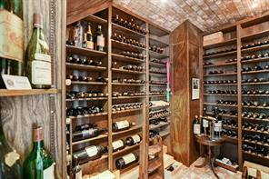 Chilled to 54 degrees with a dedicated cooling system, the wine room can accomodate approximately 1,500 bottles.