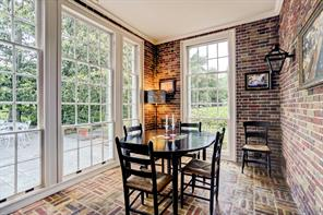 The breakfast room with patio and garden views through the triple hung windows.