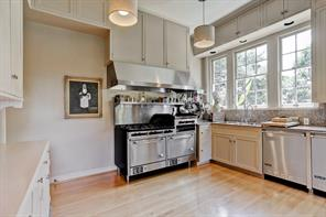 The kitchen with stainless appliances. Counter tops are oak and granite.