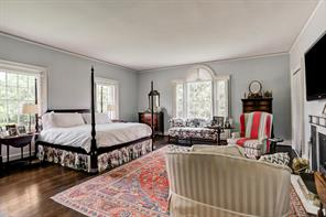 The master bedroom with fireplace and a high Palladian window on the eastern wall.