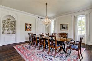 The formal dining room with a china cabinet and swinging door to the butler's pantry and kitchen.