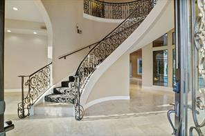 The grand foyer is sure to take your breath away upon entry. Note the imported European travertine floors.