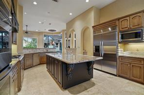 Large island provides added storage and extra counter space for meal prep.