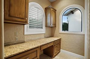 Just off of the kitchen is a chef's nook with built-in cabinets & desk. Perfect for menu planning.