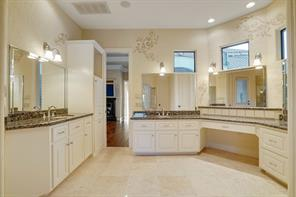 This master bath is quite large and wonderfully appointed. His and her vanities, abundant windows for natural light, faux paint detailing, and upgraded granite.