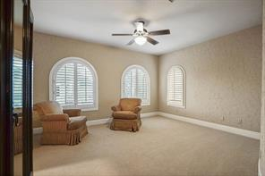One of three generous bedrooms located on the second floor. Attractive arched windows with plantation shutters really make this room shine.