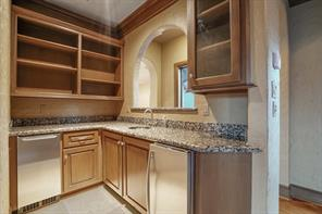 Wet bar with fridge and ice maker located just off the media room upstairs. Perfect when hosting your Superbowl or World Series events!