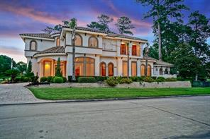 This elegant Mediterranean home rests on two and a half lots, giving you over 2/3 of an acre.
