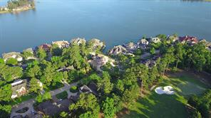 Located across the street from Lake Conroe with permanent water views.