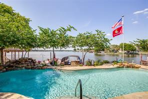 Beautiful pool, with lake view, easy access to the boat slip!