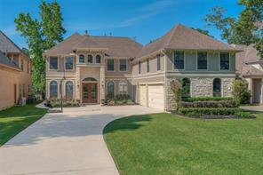 Welcome to this spacious custom home in gated Grand Harbor!