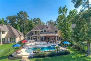 This lovely pool and spa await you. It is the centerpiece of the huge back yard.