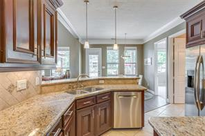 Here we can see the custom finishes on the cabinetry, tile back splash, and wonderful wood work. This spacious kitchen is perfect for entertaining.
