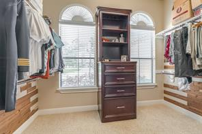Cedar planked walls and built in cabinetry complete this master closet!