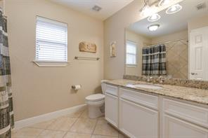 The upstairs guest bath is spacious and welcoming. Notice the attention to detail in the wood trim and granite counters!