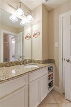 Note the generous use of cabinets and shelves in this guest bath.