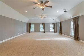 The expansive 34 x 20 media room has lovely views, high vaulted ceilings, upgraded ceiling fixtures, and is pre-wired for surround sound. Your guests will never want to leave!!