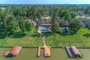 Another aerial view of the home shows the abundance of mature trees surrounding the property.
