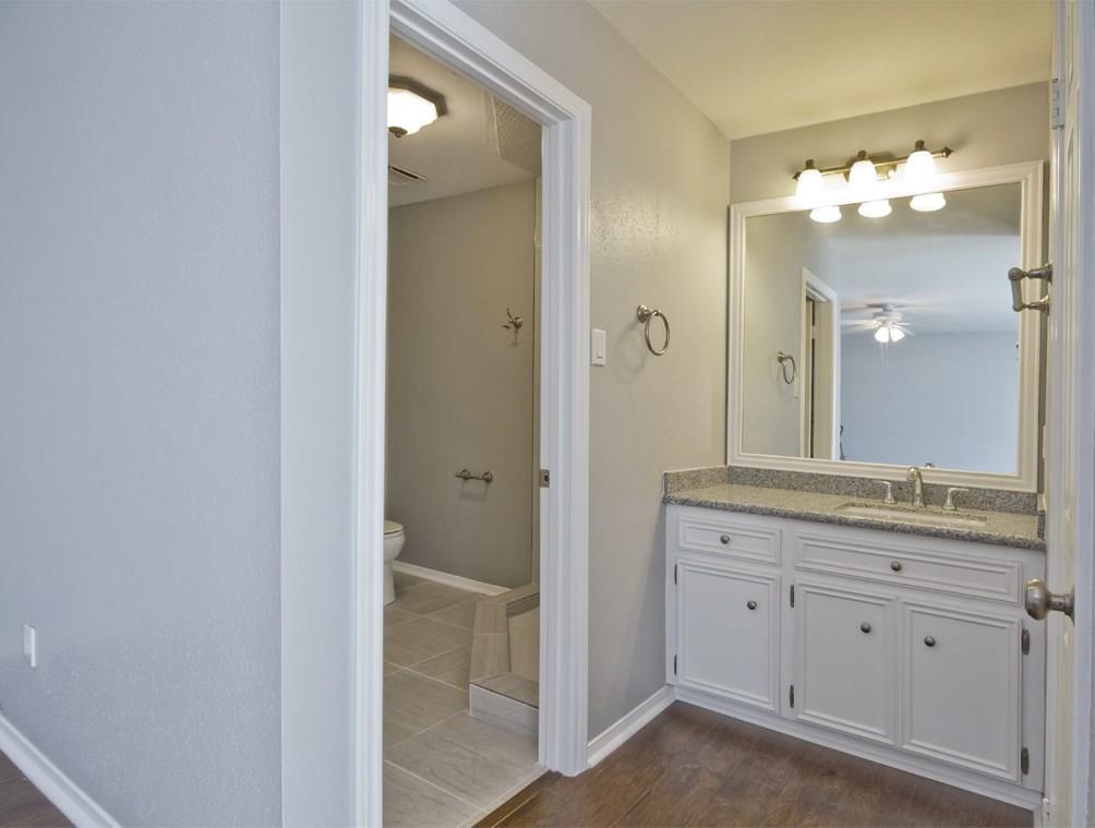 Another view of the secondary bedroom's en suite bathroom
