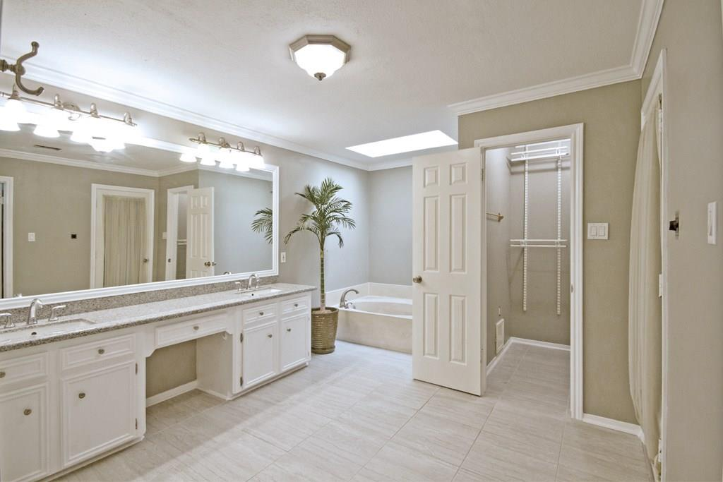 This home has been beautifully renovated - here is a view of this large master bathroom