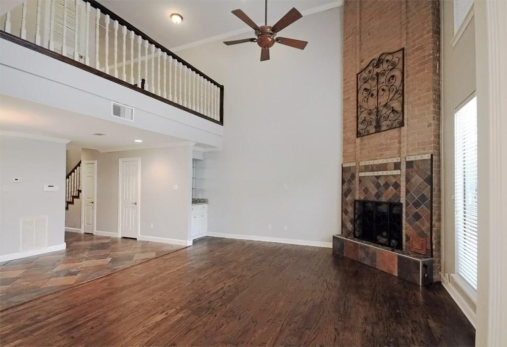 2 story ceilings in the living room with the grand gas fireplace