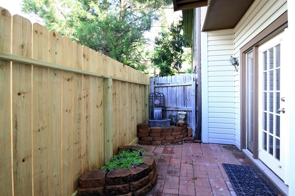 Quiet backyard patio with a brand new fence