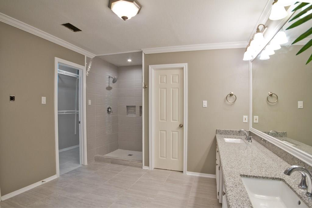 Another view of the master bathroom that includes 2 large closets