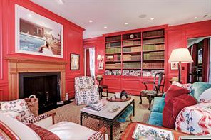 Built-in adjustable book/display shelving over cabinet storage fills the west wall of this stunning library.