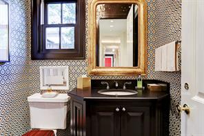 A second powder room off main hall to kitchen.
