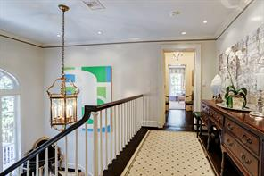 The front stairs lead to wide landing as it enters into master bedroom.
