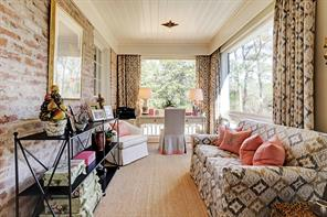 Just off the master bedroom is a quaint sunroom with paneled ceiling. Great spot for reading your favorite book.