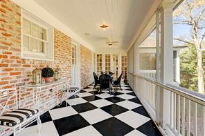 View of charming second floor balcony looking toward the French doors to sunroom and master bedroom.