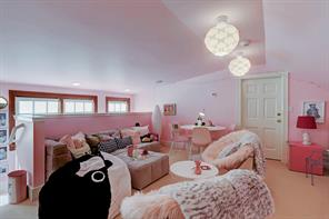 Darling third floor play room with large cedar closet and additional storage.