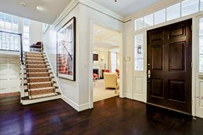 The entry opens to formal living room and front stairs to second level.