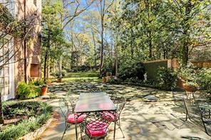 Stone patio with plenty of room for dining al fresco.