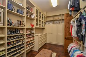 Her Closet having a separate cedar lined closet and granite top on custom built in chest.