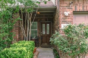 Beautiful glass leaded door and full brick entry make this home very welcoming.