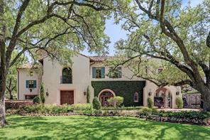 This custom Tuscan inspired home was designed by Robert Dame and built by Brian Thompson of Thompson Custom Homes and sits on a beautifully manicured lot.  Mature trees, fresh flowers and an ivy covered wall create a warm, welcoming setting that you are sure to love.  A gated porte cochere and gated driveway sit to the right of the home.
