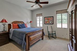This secondary bedroom, which also has room for a king bed, overlooks the backyard and pool.  The en suite bathroom connects with the closet for this bedroom.