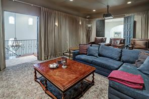 Here is another view of your home theater room.  It's located at the top of the rear stairs with two entrances.  Just through the doors on the right sits an upstairs bar and sitting area.