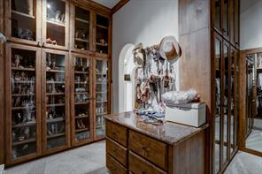 The second master closet extends the matching built-in cabinetry and features a granite countertop to one of the dressers.  Fantastic storage for those uber organized homeowners.