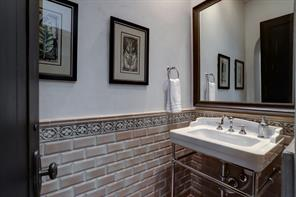 This is the stylish third half bathroom located off of the sitting and theater room on the second floor.  No need to use any of the bedroom en suite bathrooms.