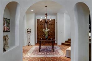 """It doesn't get much more original that this.  Look at those front doors.  These were imported specifically for this home from Mexico.  They portray a real """"old world"""" feel to the home."""