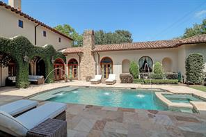 Looking from the covered outdoor kitchen, you see the pool, master wing of the home, and covered patio under the ivy-filled walls.  Private and elegant.  Just enjoy.