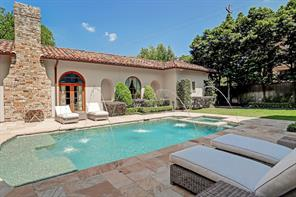 This view shows the yard space behind the pool.  Large mature trees keep your space private.  The yard extends to the other side of the master wing and offers a great space for a dog run, garden, or just more landscaping.