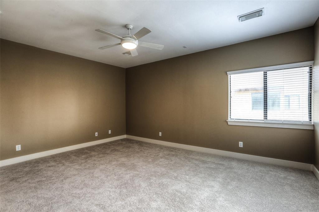 Large master bedroom with great closet space and new carpet.