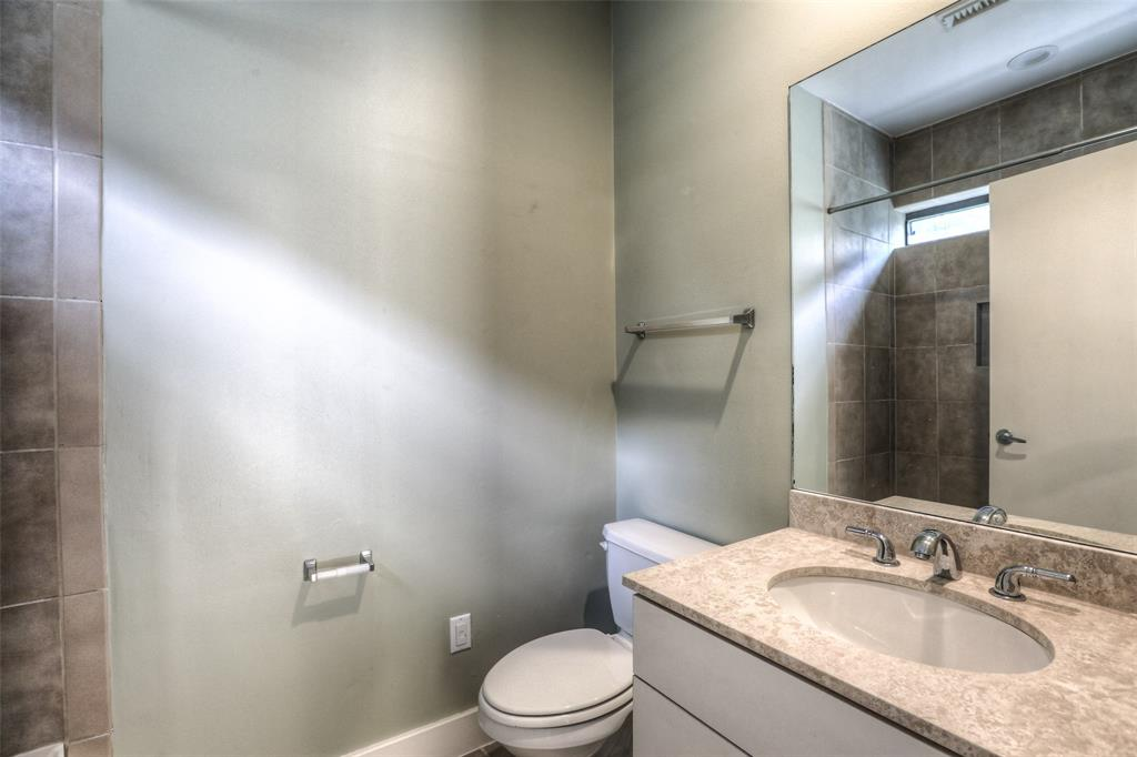 Full bath # 2 features granite counter top and tile shower surround.