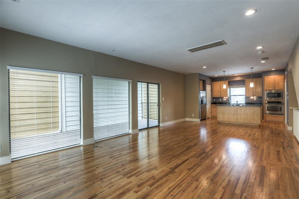 The open floor plan features refinished wood floors, LED lights, fresh paint and lots of natural light.